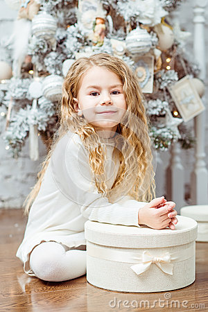 Free Lovely Blond Little Girl Sitting Under The Christmas Tree With G Royalty Free Stock Image - 35678056