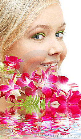 Lovely blond with orchid in water