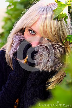 Lovely blond woman looks and hides