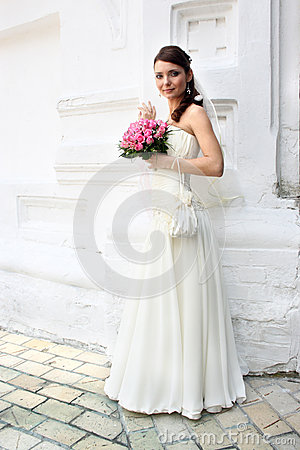 Lovely bride with bouquet from roses