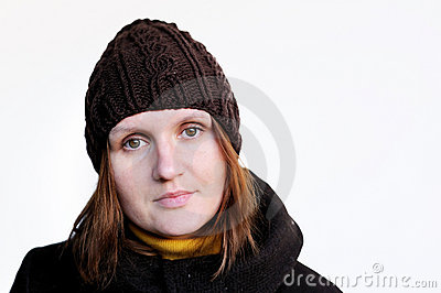 Lovely brunette woman in brown knitted hat