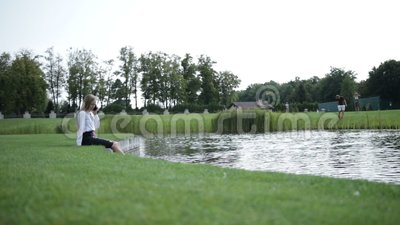 Lovely business woman relaxing in the park stock video