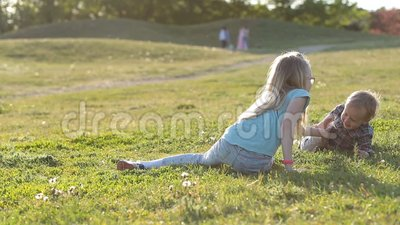 Lovely children enjoying time playing in park stock video footage