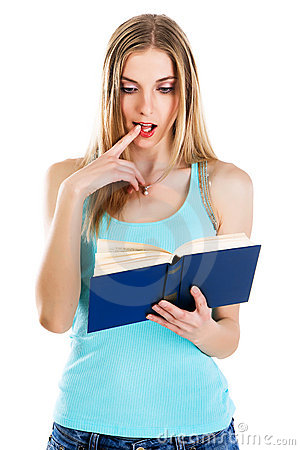 Lovely confused girl reading a book