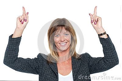 Lovely corporate woman with raised arms