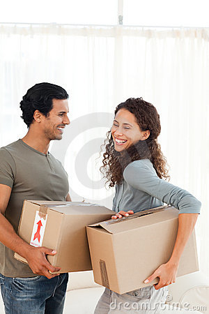 Lovely couple holding cardboards