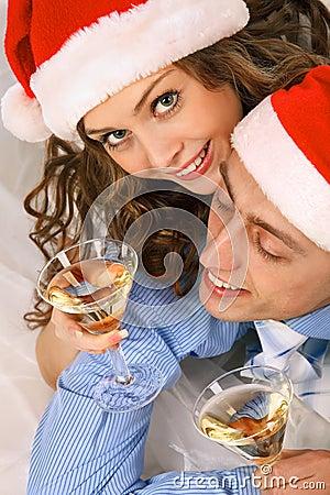 Lovely couple holding the martini glasses