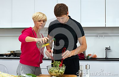 Lovely couple making a salad
