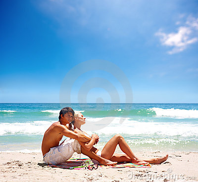 Lovely couple relaxing together at the sea shore