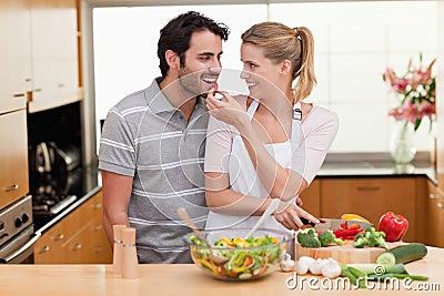 Lovely couple slicing pepper