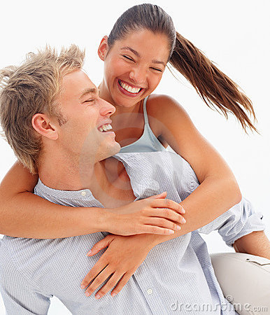 Lovely couple smiling over a white