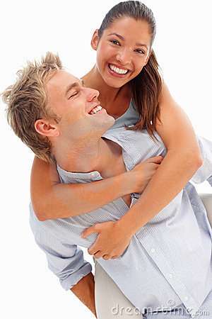 Lovely couple smiling over a white background
