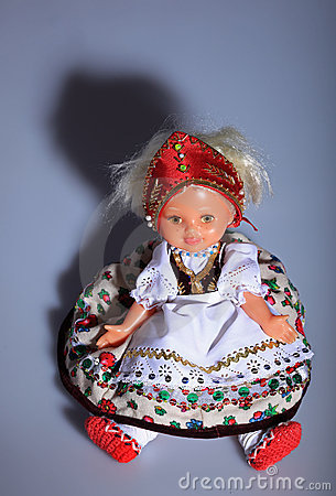 Lovely doll in folk cloth