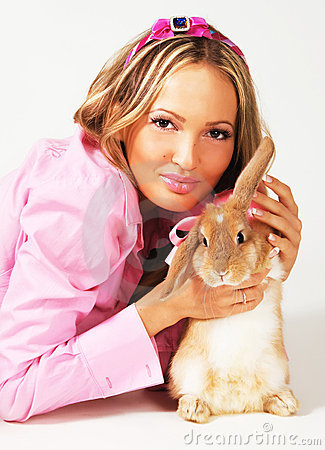 Lovely festive woman with a rabbit