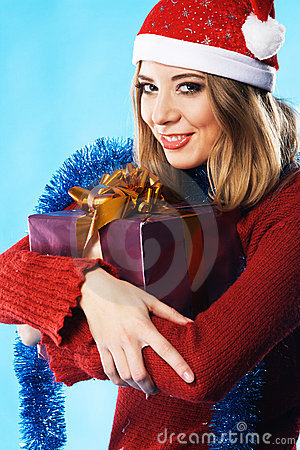 Lovely girl with Christmas gift