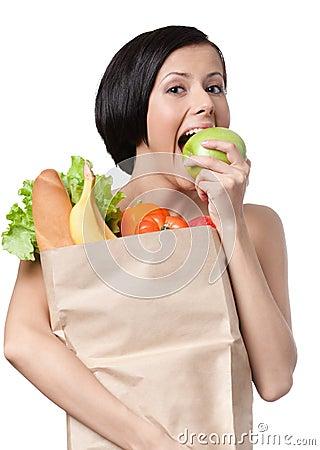 Lovely girl eats an apple
