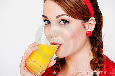 Lovely girl with glass of juice