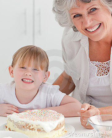 Lovely girl and her grandmother in a kitchen