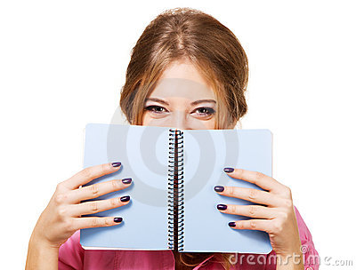 Lovely girl hiding behind notebook