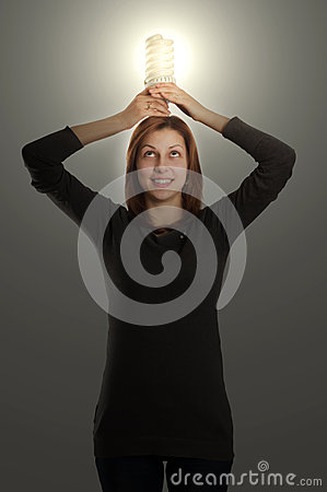 Lovely girl holding a fluorescent lamp over his head