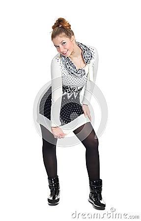 Lovely girl in a tunic posing