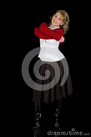 Lovely Girl in Winter Fashion Removing her Sweater