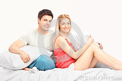 Lovely heterosexual couple in pajamas in a bed