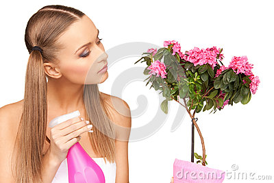 Lovely housewife with flowers