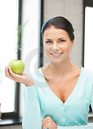 Lovely housewife with green apple