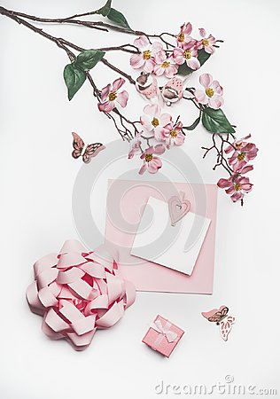 Free Lovely Pastel Pink Greeting Card Mock Up With Blossom Decoration, Hearts, Little Gift Box And Bow On White Desk Background, Top Vi Royalty Free Stock Image - 110130436