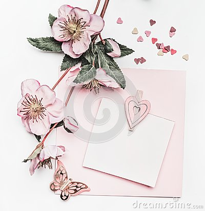 Free Lovely Pastel Pink Layout With Flowers Decoration,ribbon, Hearts And Card Mock Up On White Desk Background, Top View, Flat Lay. We Royalty Free Stock Image - 110130506