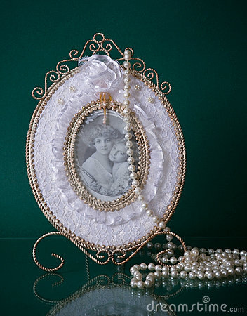 Lovely photoframe and beads on green