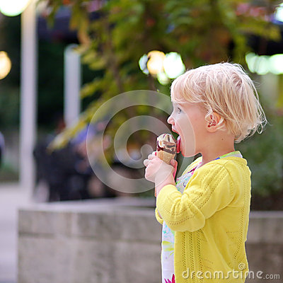 Free Lovely Preschooler Girl Eating Ice Cream Outdoors Royalty Free Stock Image - 44513926