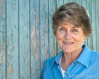 Lovely Seventy Year Old Woman Smiling in Blue Shir