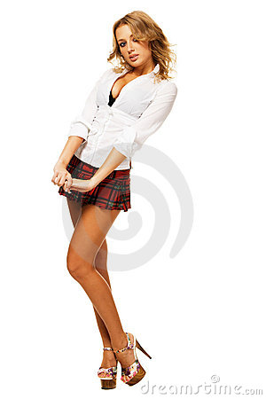 Lovely sexy girl in checkered short skirt