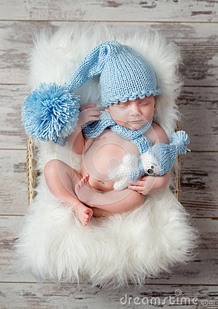 Free Lovely Sleeping Baby In Hat With Big Pompon On Fluffy Cot Royalty Free Stock Photo - 73892565