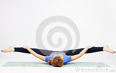 Lovely sporty woman doing stretching exercise
