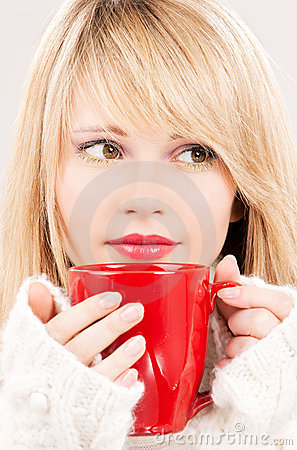 Lovely teenage girl with red mug