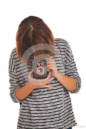 Lovely teenage girl with retro photo camera