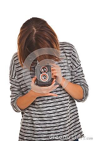 Lovely teenage girl with retro photo camera