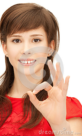 Lovely teenage girl showing ok sign Stock Photo