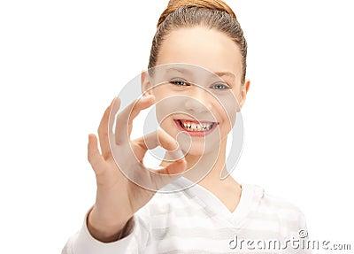 Lovely teenage girl showing ok sign Stock Photo
