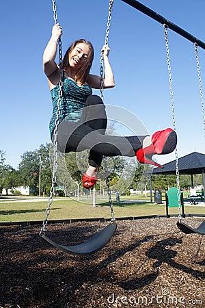 Lovely, Voluptuous Brunette on a Swing (5)