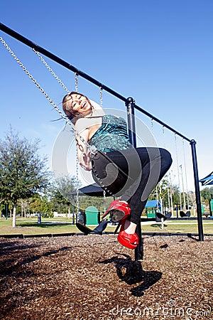 Lovely, Voluptuous Brunette on a Swing (8)