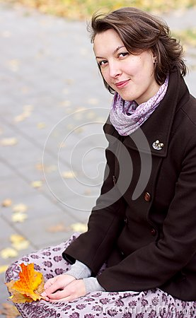 Lovely woman with autumn leaves