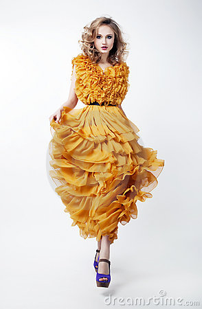 Lovely woman blonde fashion model in yellow dress