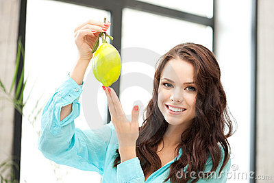 Lovely woman with lemon