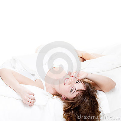 Lovely woman resting in the white bed
