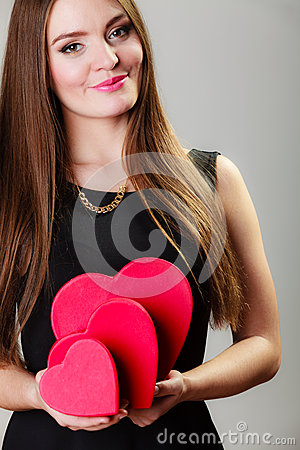 Free Lovely Woman With Red Heart Shaped Gift Boxes Stock Images - 49971284