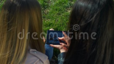 Lovely women surfing the net with digital tablet stock footage